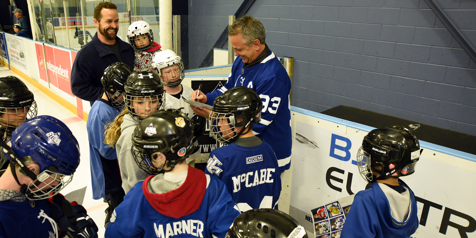 A group of kids surround Doug Gilmour